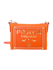 7d3d54569c65 Distressed Leather Clutch.  495.00 · Prada