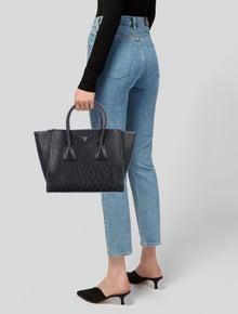6a6a155ecdb8 Prada Handbags   The RealReal