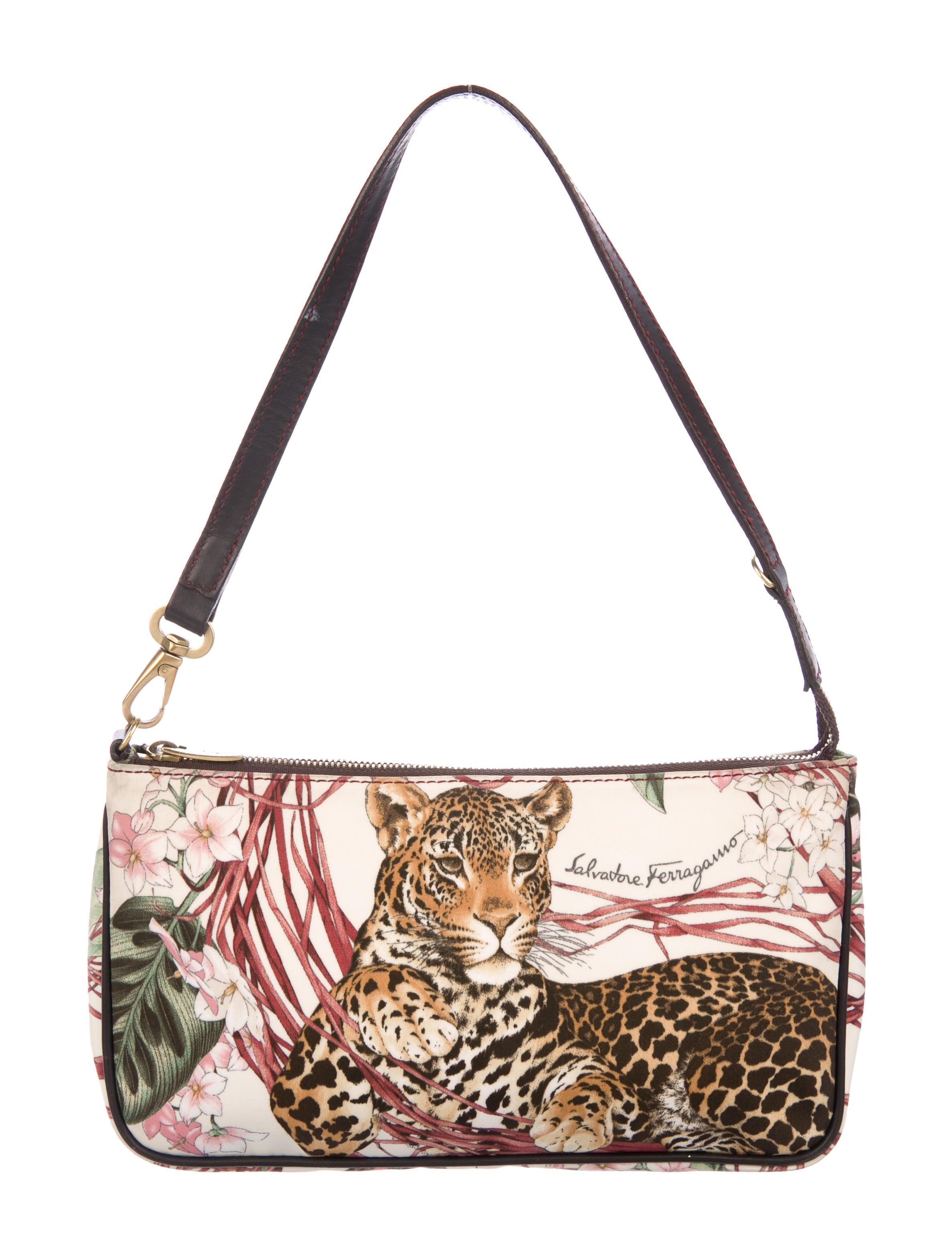 bed7ccef56be Salvatore Ferragamo Leather-Trimmed Jaguar Pochette - Handbags ...