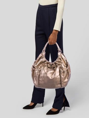 d6b64bf7b90 Leather Crossbody Bag.  125.00 · Salvatore Ferragamo
