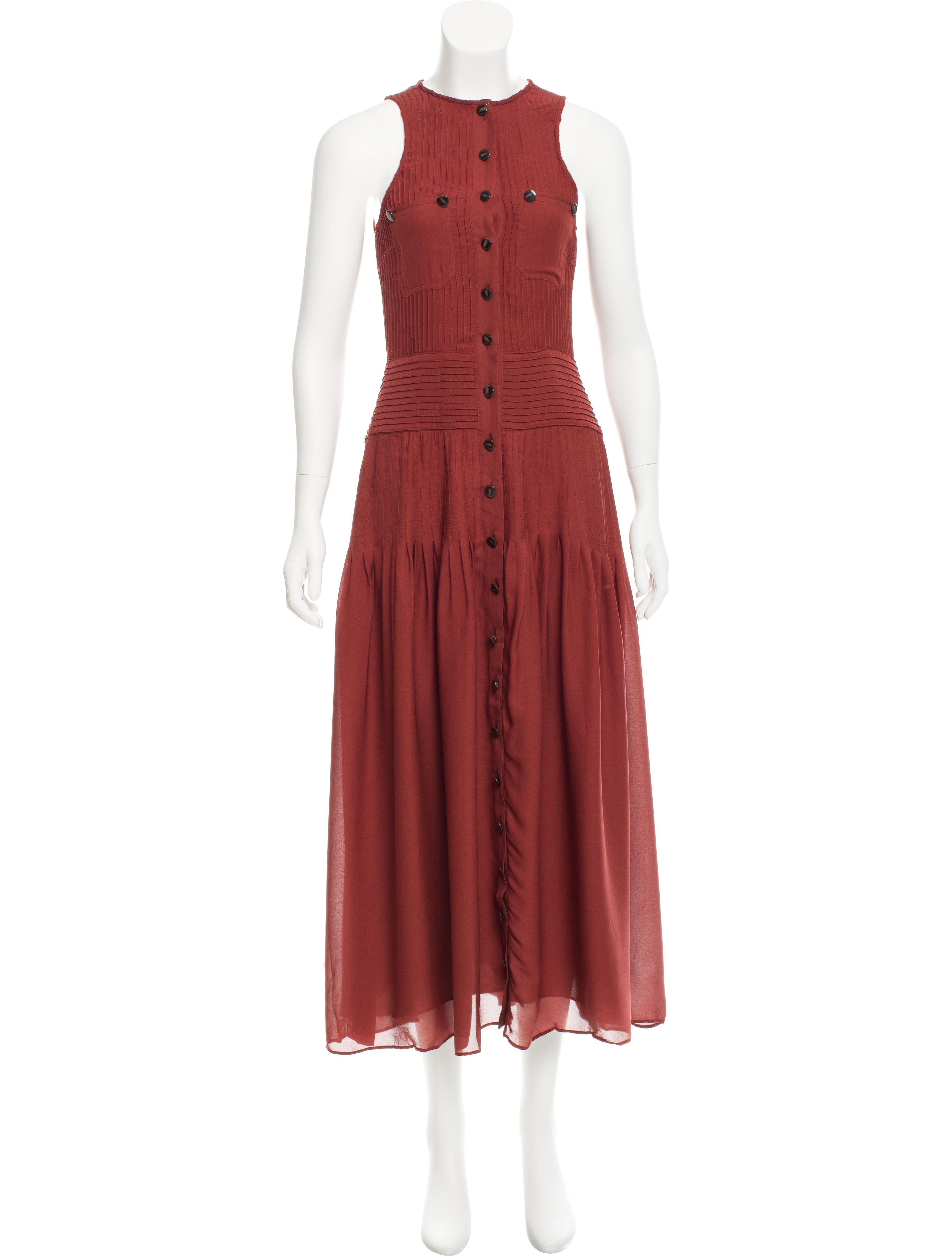 Detailed with a pleated front, Giorgio Armani's dress is composed of red silk georgette. A classic look from the Italian designer, the chic style is softly tailored for a figure-accenting effect.