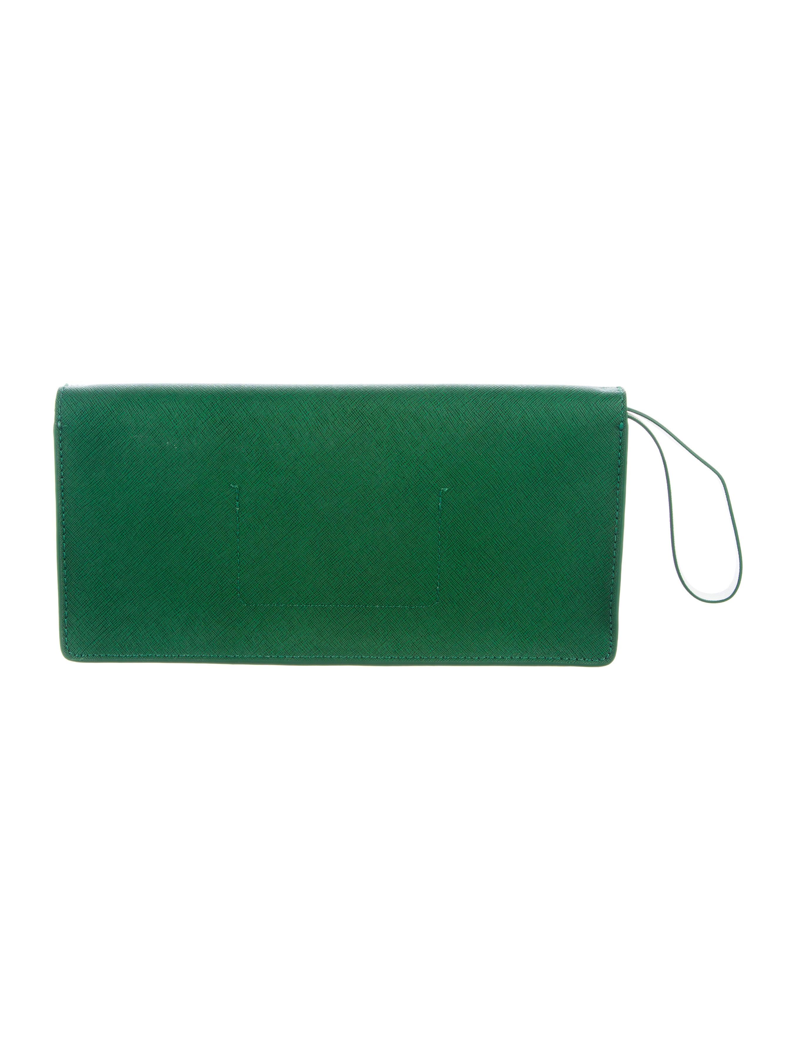 Kate Spade New York Lily Avenue Kiki Clutch Handbags  : WKA655364enlarged from www.therealreal.com size 2706 x 3570 jpeg 582kB