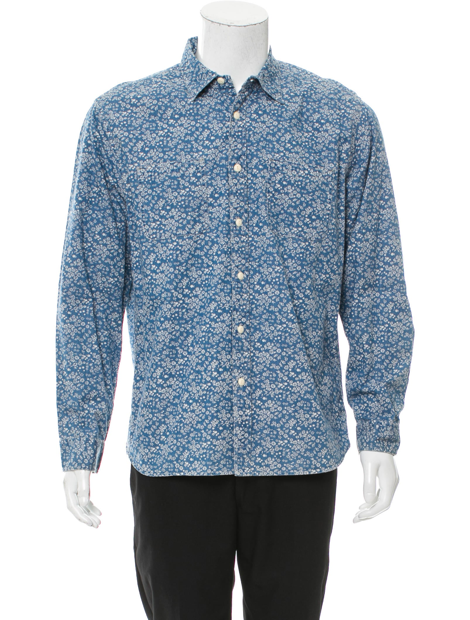 The Natural Reflections® Floral Print Back Chambray Shirt for women is a bright, colorful look for warm days. The front is made of classic chambray, while the back showcases a pretty floral print design.