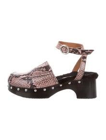 8e1c1f7521 Nicole Saldana. Embossed Animal Print Sandals