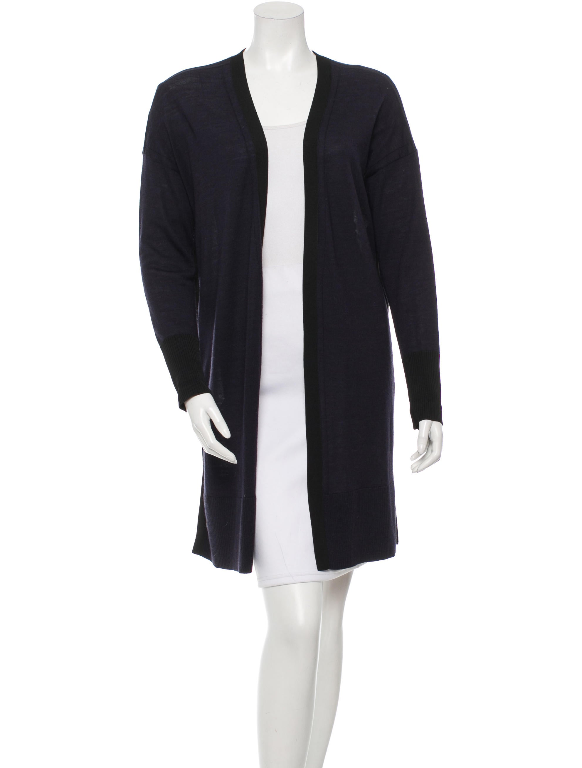 Moncler Wool Cardigan w/ Mohair Front Details Moncler cardigan featuring mohair-blend front. Spread collar; two-way zip front. Long sleeves. Standard silhouette. Hip-length hem. Mohair/cotton front. .