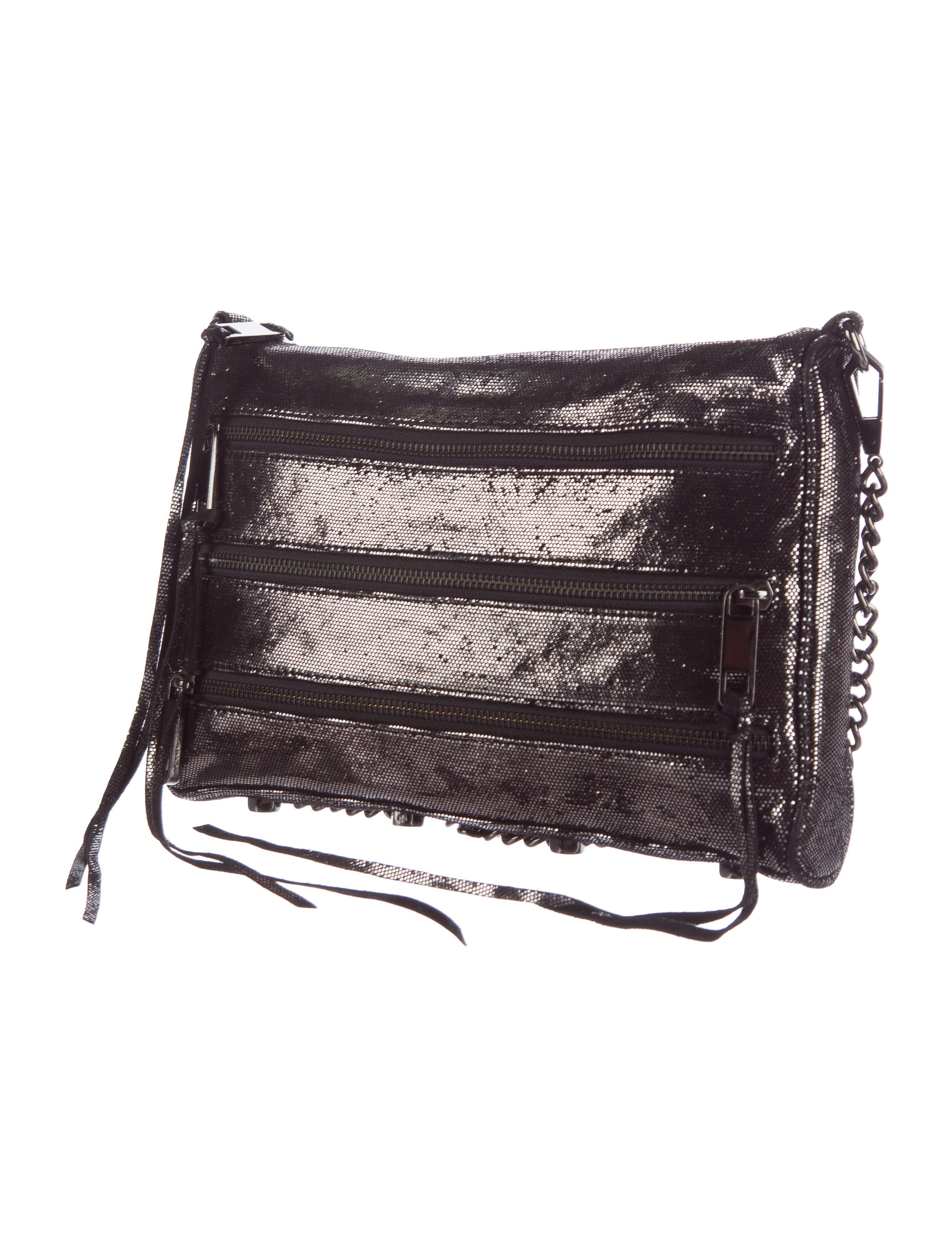 Her exclusive crossbody bag design includes a back zippered pocket for your cell phone, an inside lining with extra pockets, a secure top zippered closure .