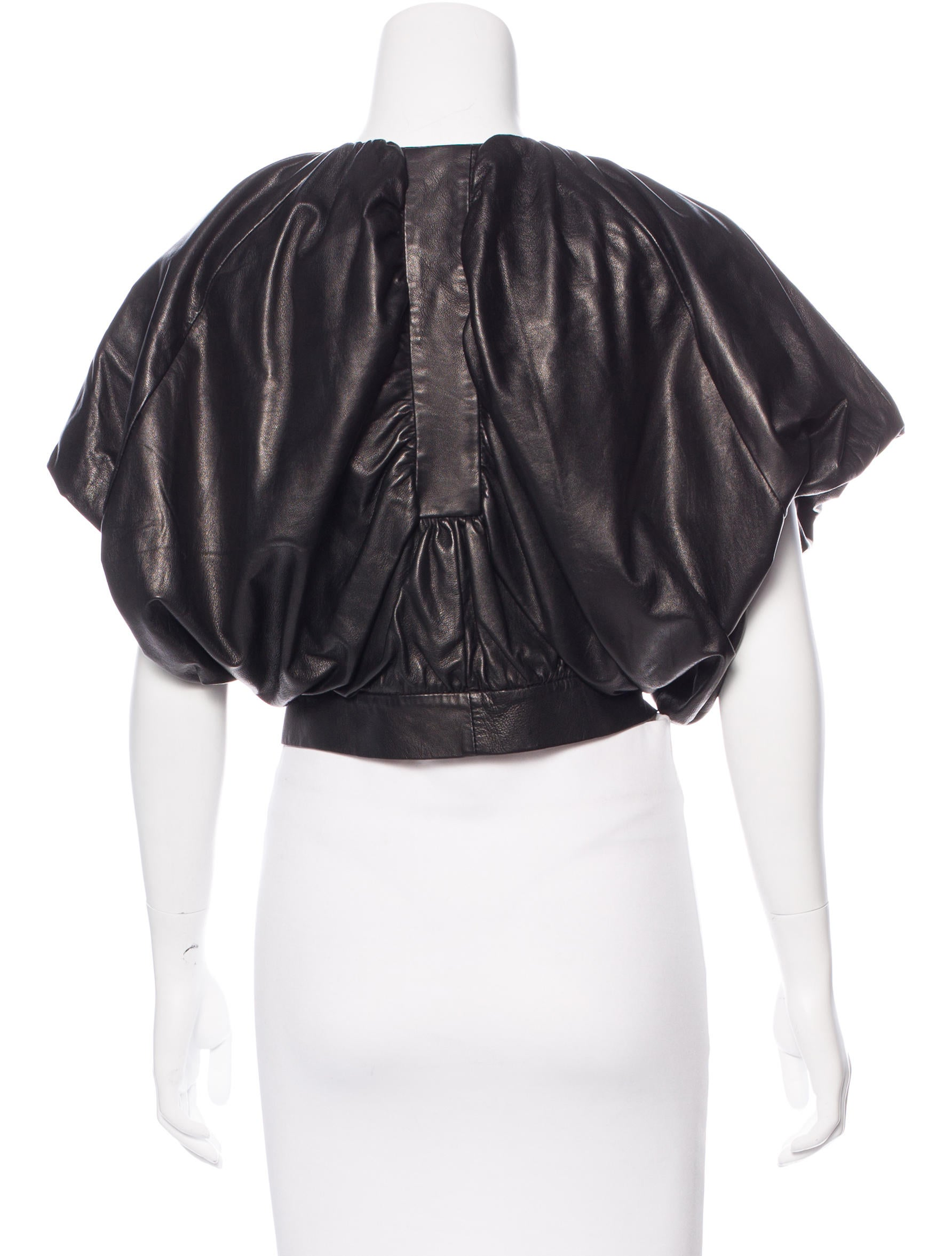 Jamison short sleeve leather jacket. This jacket is fully lined, has two exterior zippered pockets and has an elasticized waist band, sleeve cap and collar. Jacket has a zippered closure.