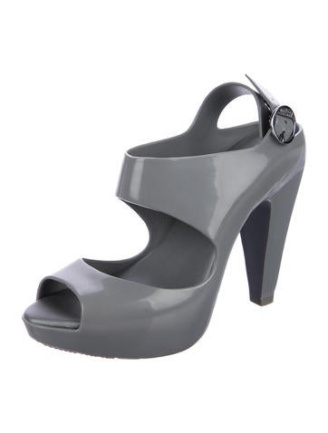 Devious Shoes | INDULGE This fetish platform pump is approximately Inch stiletto heel with ankle strap and pointy toe front. The ankle strap is a wide cuff with keypad lock. $