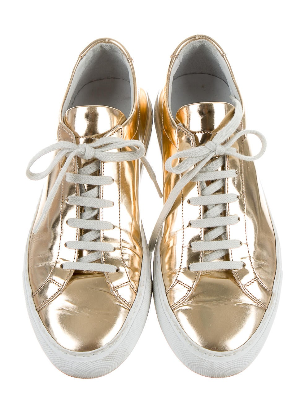 woman by common projects The luxury sneakers common projects brand resulted from the collaboration between designers flavio girolami and prathan poopat the brand, whose name is inspired by the many joint projects carried out by.