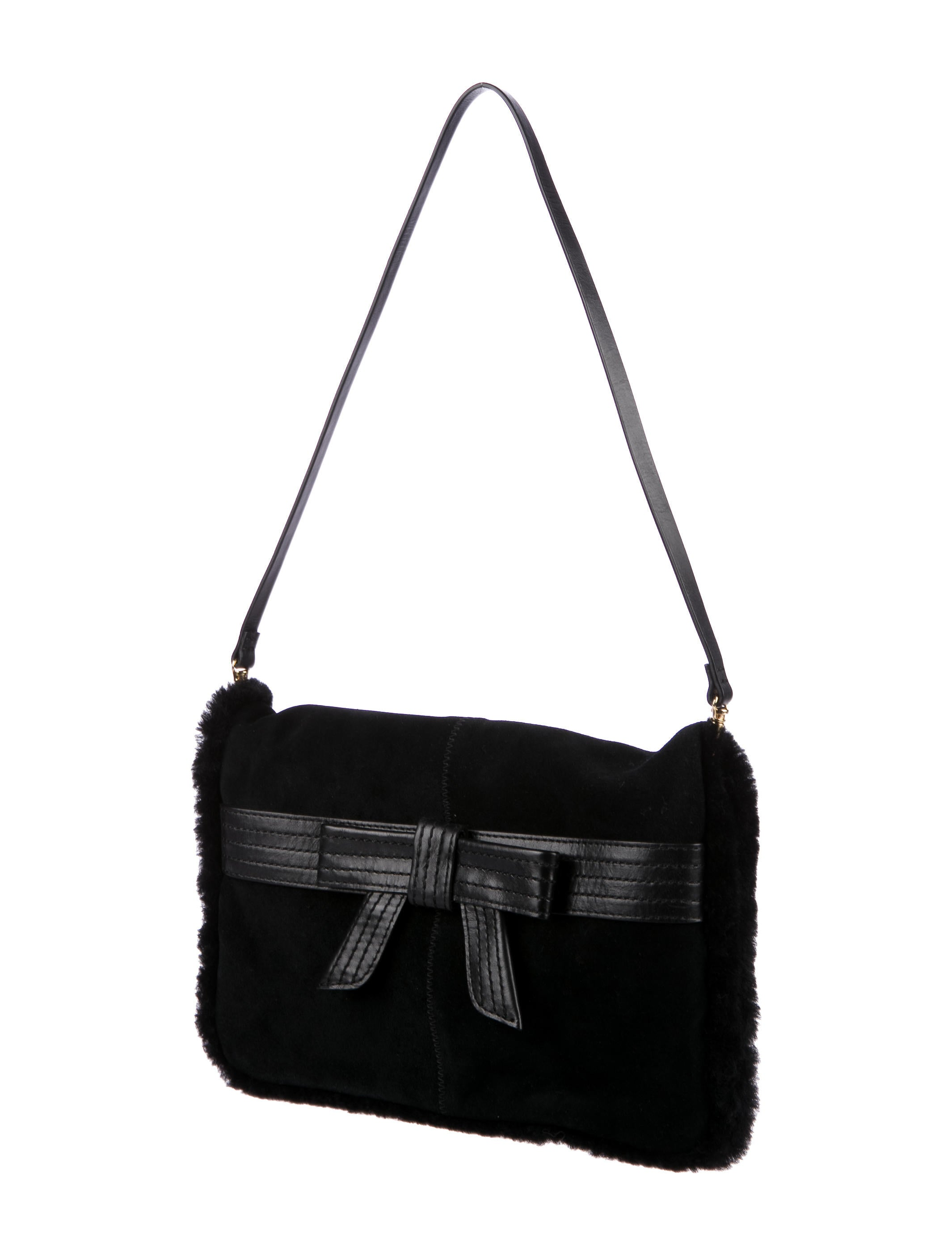⭐ UGG Australia ⭐ Black Genuine Leather Shoulder Bag / Clutch This UGG Australia shoulder bag features gold tone hardware, adjustable shoulder strap ( drop), which can also be removed and turn into a clutch bag, and front Zip.