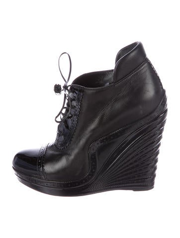 Yves Saint Laurent Leather Wedge Booties None