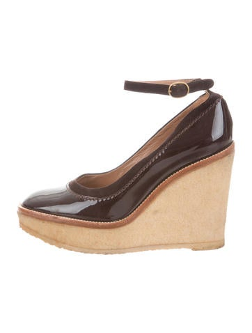 Yves Saint Laurent Patent Leather Wedge Pumps None